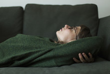 Girl Laying On A Green Sofa An...