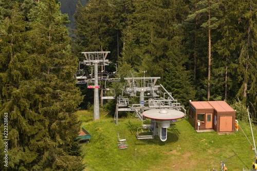 Chair lift - The most common and easiest way to reach the top of the mountain.Chairlift in summer - the base with operator at the top of the mountain.