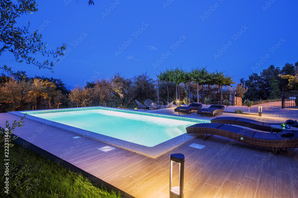 Fototapety, obrazy: Holiday home with swimming pool at night