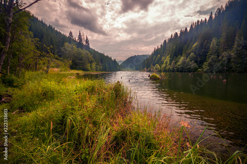 Beautiful lake in the mountains on a cloudy day shot in Romania