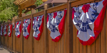 Patriotic Flags Hung On A Wood...