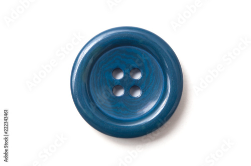 Photo sur Toile Macarons closeup of blue sewing buttons on white background