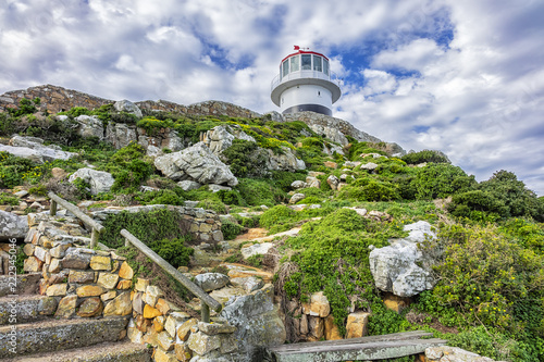 Montage in der Fensternische Leuchtturm Old lighthouse (1857) sits on top of cliffs of Cape Point in Cape of Good Hope Nature Reserve on southern tip of Cape Peninsula in South Africa. The Atlantic and Indian oceans converge at Cape Point.