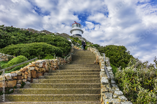 Old lighthouse (1857) sits on top of cliffs of Cape Point in Cape of Good Hope Nature Reserve on southern tip of Cape Peninsula in South Africa. The Atlantic and Indian oceans converge at Cape Point.