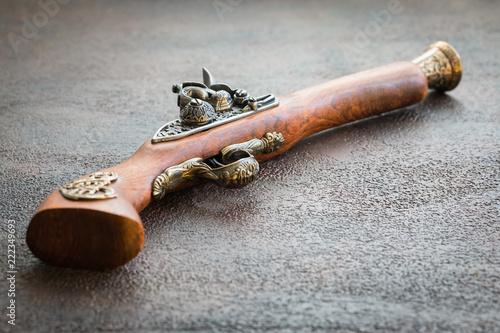 Photographie  Old vintage wooden pistol on wooden background