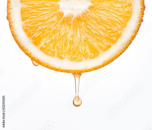Orange slice dripping juice