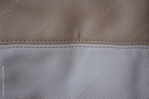 Fotografie, Obraz  Part of a leather bag of beige and white , horizontal image