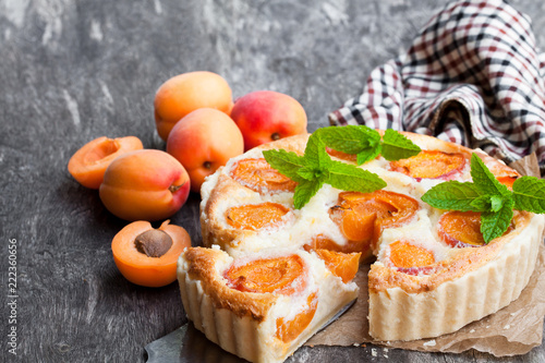 Valokuva  Homemade  cheese cake with apricot on wooden table