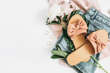 Woman fashion background with white peony flower, slippers, sunglasses, earrings, shorts, t-shirt. Flat lay, top view beauty or fashion blog lifestyle concept.
