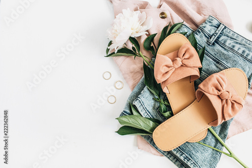 Woman fashion background with white peony flower, slippers, sunglasses, earrings, shorts, t-shirt. Flat lay, top view beauty or fashion blog lifestyle concept. - fototapety na wymiar