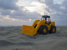 Toy Wheel Loader On The Sand A...