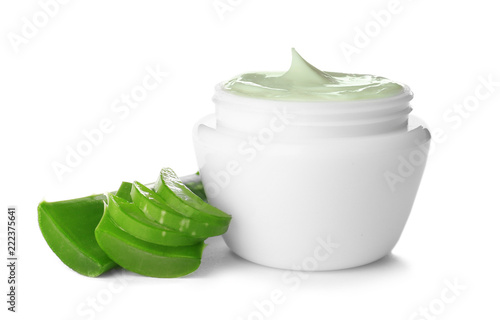 Jar with aloe vera balm and sliced leaves on white background
