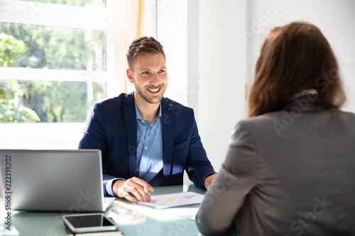 Valokuva  Businessman Looking At Job Candidate