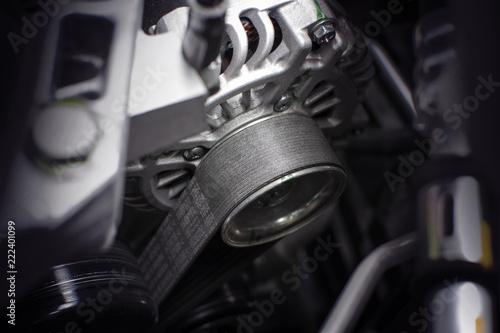 Photo Timing belt of alternator in engine room of car, automotive part concept