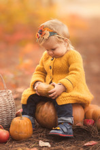 Cute Little Girl Playing In Autumn Forest