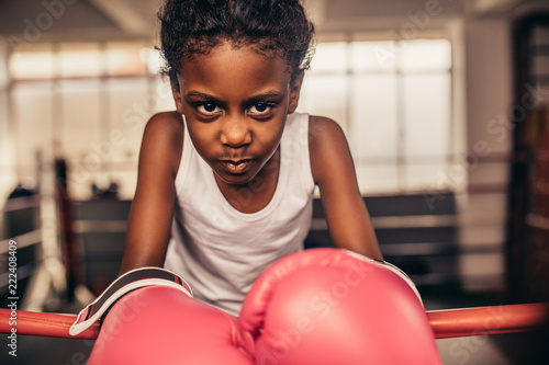 Fotografie, Obraz  Close up of a boxing kid wearing boxing gloves
