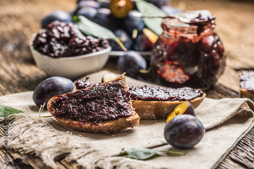 Breakfast from homemade plum jam bread and ripe plums.
