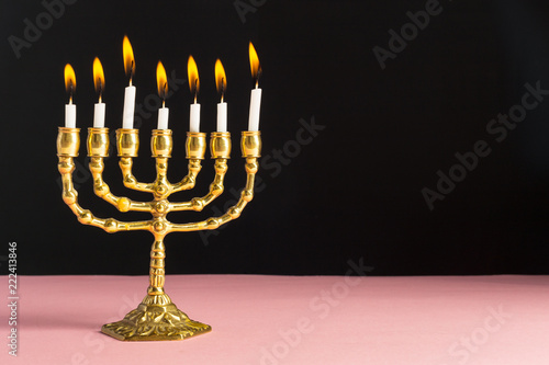 Photo  Bronze Hanukkah menorah with burning candles