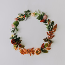 Creative Layout Made Of Autumn Fruits And Leaves With Summer Flowers And Green Leaves. Minimal Flat Lay Wreath. Changing Seasons Concept.