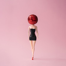 Girl In Black Dress With Red Disco Ball Head. Minimal Party Concept.