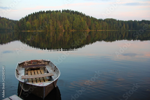 Fotografie, Obraz  beautiful photo with lake view with almost smooth water, tied boat, forest on th