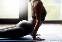 Sporty Woman Practicing Yoga, Doing Upward Facing Dog Exercise, Urdhva Mukha Shvanasana Pose, Working Out, Wearing Sportswear, Grey Pants And Top, Body Close Up View, Indoor Yoga Studio