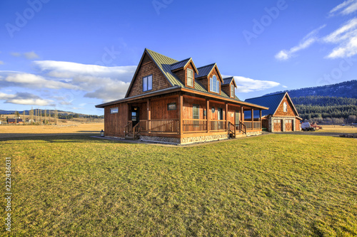 Obraz Nice wooden ranch home with beautiful landscape in the countryside. - fototapety do salonu