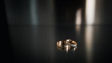 Wedding Rings On A Steel Dark Background