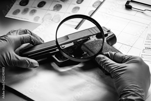 Fotografie, Tablou Detective through a magnifying glass looking at a evidence