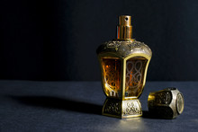Arab Perfume In A Bottle, Isolated In Black Background, In Low Light Condition