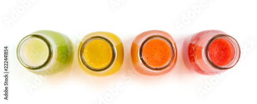 Colourful smoothie juice bottles isolated on white background