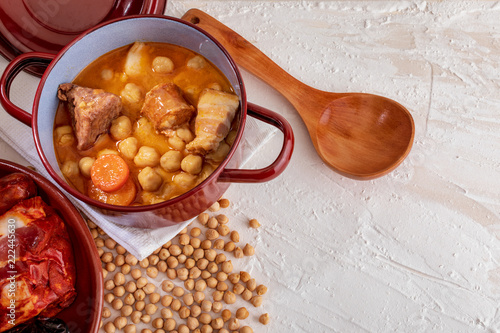 Homemade chickpea stew Madrid stew of chickpeas, meat and vegetables (chorizo, blood sausage, ham, garlic, onion, carrot, veal, chicken). Typical Spanish dish