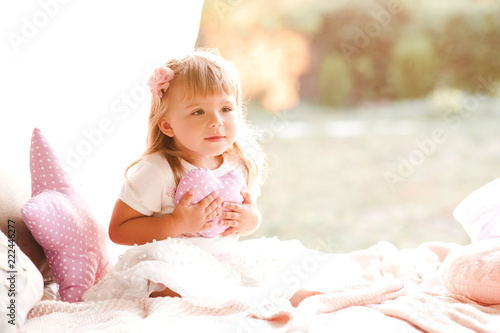 Cute Baby Girl Holding Heart Pillow In Bed Childhood Good Morning