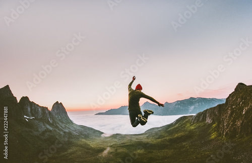 Jumping man in mountains vacations outdoor Travel Lifestyle adventure concept ac Canvas Print