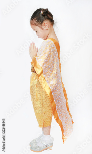 35231a8326406 Portrait of asian child girl in traditional thai dress praying isolated on white  background. (
