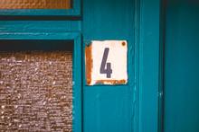 Number 4 Door Sign On Vintage Background