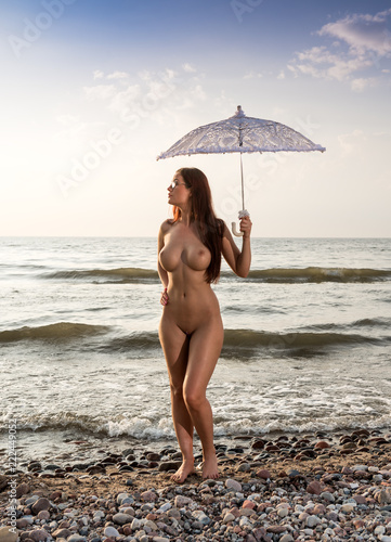 Beautiful Nude Woman Posing With White Umbrella At The Beach Buy