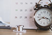 Doctor Office With Calendar , Alarm Clock And Stethoscope On Desk