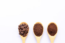 Wooden Spoons Filled With Coffee Bean And Crushed Ground Coffee On White Background