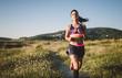 Sportswoman jogging on path