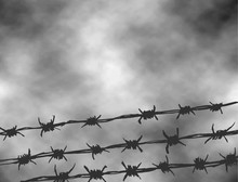 International Day Of Fascist Concentration Camps And Ghetto Prisoners Liberation. Black And White Vector Illustration To The Holocaust. Fence Made Of Wire With Spikes Isolated On Grey Sky Background.