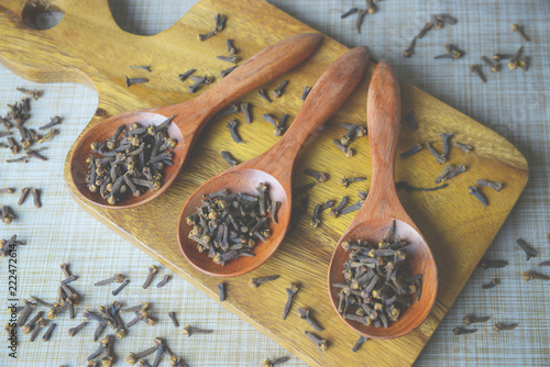 Cloves (spice) and wooden spoon