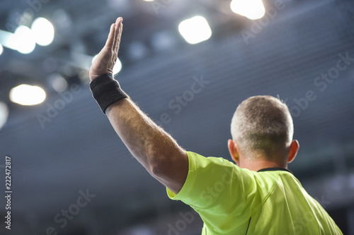 handball referee with raice hand