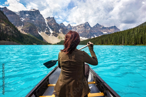 Fototapeta Female tourist rowing boat on Moraine Lake in Banff National Park, Canadian Rockies, Alberta, Canada. obraz na płótnie
