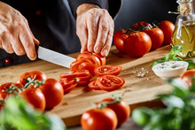 Chef Slicing Fresh Ripe Tomato...