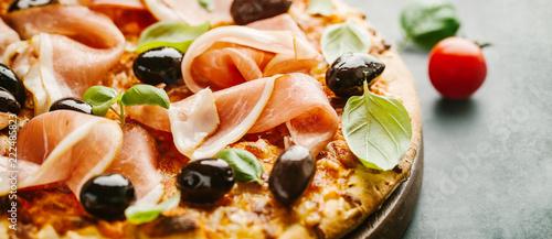 Traditional italian pizza on dark table Fototapet