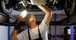 Male mechanic servicing a car 4k