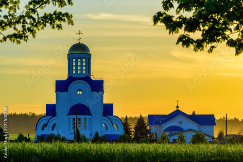 village church on a meadow in the evening