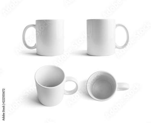 White ceramic mugs. Cups for coffee or tea isolated on white background. Responsive design mockup.