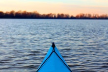 View From The Blue Kayak On The River Banks In Fall Season. Bow Of Blue Kayak On Danube River. Kayaking On Peaceful Calm Lake Or River At Sunny Autumn Evening